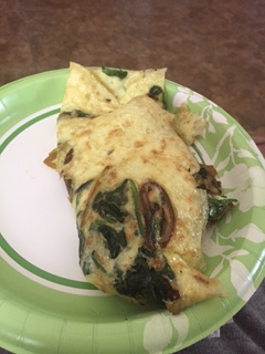 Quail egg omelet with spinach and mushrooms